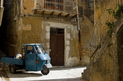 Italy, Sicily Street view. The famous three-wheel transportation in an old town in Sicily, Italy Stock Photography