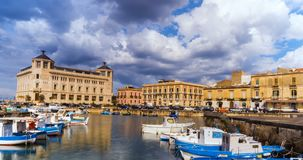 Italy, Sicily, Syracuse old town boats on port stock video footage