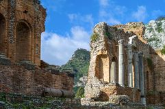 Sicily. Italy, Sicily, Taormina, the Greek theatre with Castelmola in the background royalty free stock photography