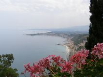 Italy Sicily Taormina View Over The Bay. June blooming flowers Stock Photo
