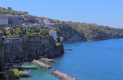 Italy Sorrento. View of the coastline of Sorrento in Italy with the jetties used for sunbathing on a clear sunny day Stock Image