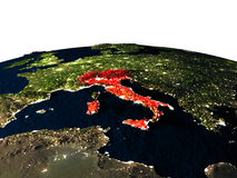Italy from space at night. Italy at night as seen from Earth's orbit in space. 3D illustration with highly detailed realistic planet surface and city lights Royalty Free Stock Images