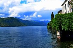Lake Orta Italy. Italy square sky windows cloud tower colors country road street courts green door panorama sunset courts sleep square Stock Photo