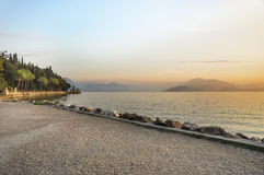 Italy. Sunset on Lake Garda with views of the Alps. Stock Images