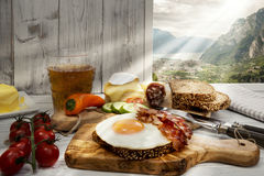 Italy, Torbole, Supper, fried egg and bacon on protein bread Stock Photo