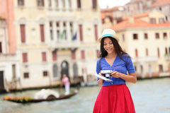 Italy travel - young woman tourist in Venice canal Royalty Free Stock Images