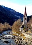 Italy, Trentino Alto Adige, Bolzano, San Candido, view of the Aurino River with the small church dedicated to the Holy Spirit. Trentino Alto Adige, Bolzano, San stock image