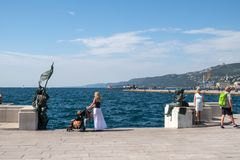 Italy, Trieste, woman observes the sea from the square Royalty Free Stock Photo
