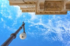 Trieste, the architectures and arts. Italy, Trieste, Unità D`Italia square, upward view of a street lamp Stock Photos