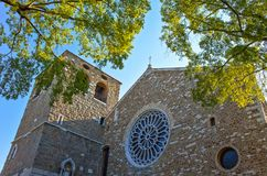 Trieste, the architectures and arts. Italy, Trieste, upward view  of the facade and bell tower of the San Giusto cathedral Stock Photography