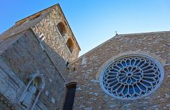 Trieste, the architectures and arts. Italy, Trieste, upward view  of the facade and bell tower of the San Giusto cathedral Stock Image