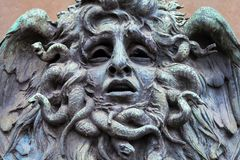 Mask of Medusa. Italy, Turin. This city is famous to be a corner of two global magical triangles. This is a Medusa`s head made of bronze close to the historical stock photos