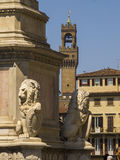Italy,Tuscany,Florence, Arnolfo tower and lion statue in Santa Croce square. Stock Photo