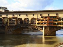 Italy, Tuscany, Florence, the Ponte Vecchio bridge. Italy, Tuscany, Florence, the Ponte Vecchio bridge and the Arno river Royalty Free Stock Photo