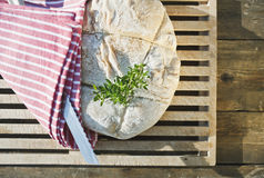 Italy, Tuscany, Magliano, bread and knife, elevated view Royalty Free Stock Images