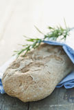 Italy, Tuscany, Magliano, Close up of bread on wooden table Royalty Free Stock Images