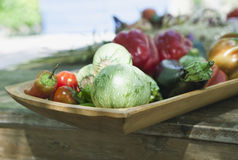 Italy, Tuscany, Magliano, Close up of various vegetables in wood tray Royalty Free Stock Images
