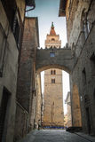 Italy, Tuscany, Pistoia. The bell tower of Cathedral. Italy, Tuscany, Pistoia. The bell tower of Cathedral and arch in the old city Stock Photo
