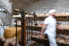 Italy, Tuscany, the province of Florence, Greve in Chianti, cheese shop. Italy, Tuscany, the province of Florence, Greve in Chianti, a worker in an ancient royalty free stock photo