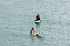 Italy Tuscany sea 18 July 2018 : Surfing on the north shore . a couple waits for the wave on a surfboard.  royalty free stock images