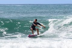 Italy Tuscany sea 18 July 2018 : Surfing on the north shore . Man at surf in italy . Italy Tuscany sea 18 July 2018 : Surfing on the north shore . Man at surf royalty free stock photography