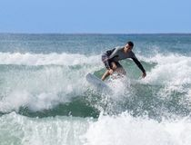 Italy Tuscany sea 18 July 2018 : Surfing on the north shore . Man at surf in italy . Italy Tuscany sea 18 July 2018 : Surfing on the north shore . Man at surf stock photo