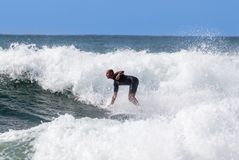 Italy Tuscany sea 18 July 2018 : Surfing on the north shore . Man at surf in italy . Italy Tuscany sea 18 July 2018 : Surfing on the north shore . Man at surf stock photography