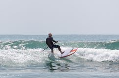 Italy Tuscany sea 18 July 2018 : Surfing on the north shore . Man at surf in italy . Italy Tuscany sea 18 July 2018 : Surfing on the north shore . Man at surf stock images
