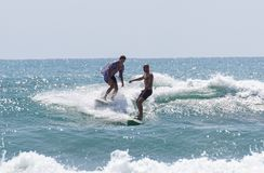 Italy Tuscany sea 18 July 2018 : Surfing on the north shore . Man at surf in italy . Italy Tuscany sea 18 July 2018 : Surfing on the north shore . Man at surf royalty free stock image