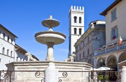 Architectures and religion in Assisi. Italy,Umbria,Assisi,the fountain and the Del Popolo tower in Municipal square Stock Photos