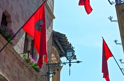 Architectures and religion in Assisi. Italy,Umbria,Assisi,medieval houses and flags in the old country center Royalty Free Stock Images