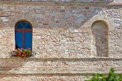 Architectures and religion in Assisi. Italy,Umbria,Assisi, the windows of an ancient palace in the country  center Royalty Free Stock Image
