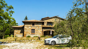 Italy,Umbria,Cioccoleta near Orvieto, Rural Landscape. Italy,Umbria,Orvieto - Rural Landscape,village with the house casa,olive tree and car behind the olive royalty free stock image