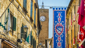 Italy,Umbria,Orvieto,the banner and the tower. Italy,Umbria,Orvieto - the banners,the tower with the clock Stock Images