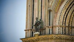 Italy,Umbria,Orvieto the Cathedral(Duomo). Facade detail, bronze angel stock photo