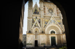Italy,Umbria,Orvieto,the Duomo through the Arc. Italy,Umbria,Orvieto - the Cathedral Duomo through the arc,gothic church stock images