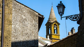 Italy,Umbria,Orvieto,the lamp and the church bell. Italy,Umbria,Orvieto - the lamp,the church and the bell stock photos