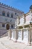 The ancient architectures of Perugia. Italy,Umbria,Perugia, IV November square,  detail of the Maggiore fountain with the Dei Priori palace in the background Royalty Free Stock Photography