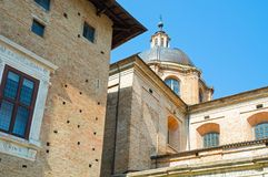 Urbino. Italy, Urbino, the Cathedral dome with the Ducal Palace in the foreground left Stock Image