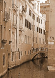 Italy. Venice. Canal with bridge among old colorful brick houses Royalty Free Stock Image