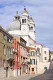 Italy. Venice. The Cathedral of Santa Maria della Salute and bell tower Stock Images