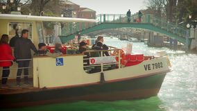 Italy, Venice - February, 2019: Townspeople are sitting on board of vaporetto in sunny morning stock footage