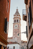 Italy, Venice, February 25, 2017. a clock tower in Venice among Royalty Free Stock Photography
