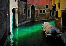 Italy, Venice. Gondola in a narow canal stock photography