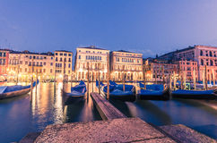 Italy Venice grand canal gondola pier row anchored overnight. Stock Photography