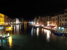 Italy, Venice - Grand Canal at night is full of lights and color. The Grand Canal in Venice never sleeps. Even as the lights in the buildings are out, those in royalty free stock photography