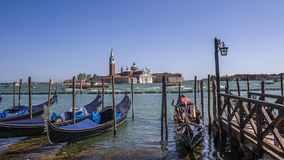 Gondolas on the background of San Giorgio Maggiore. Italy, Venice. Jetty to the gondola on the background of San Giorgio Maggiore is a 16th-century Benedictine royalty free stock image
