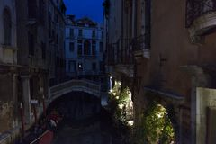 Italy. Venice. Night view of the wonderful traditional Venetian canal with a bridge over it.  royalty free stock photos