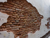 Italy, Venice - Old Brick Wall Shows Brick Is Stronger than Mortar. This old wall in an alley in Venice is falling apart and yet the bricks behind the plaster stock photos