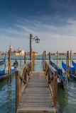 Italy, venice pier. A typical venice pier on a sunny day Stock Images